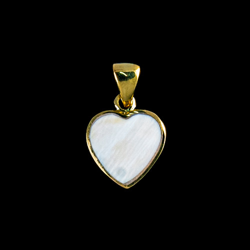 """This unique heart shaped mammoth ivory tusk is inlayed into a14K Gold pendant. This pendant comes with an 18"""" 14K Gold chain. The dimensions of themammoth pendant tusk is approximately .58"""" x .50""""."""