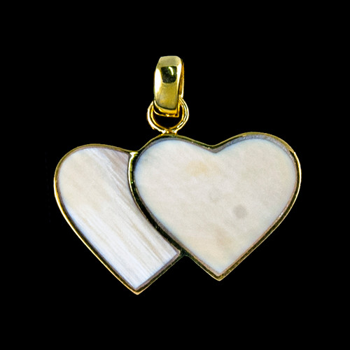 """This beautiful large double heart shaped mammoth ivory tusk is inlayed into a 14K Gold pendant. This pendant comes with an 18"""" 14K Gold chain. The dimensions of themammoth pendant tusk is approximately .92"""" x 1.61""""."""