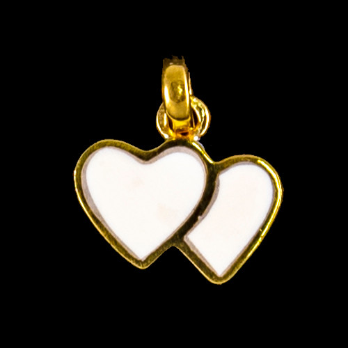 """This elegant small double heart shaped mammoth ivory tusk is inlayed into a 14K Gold pendant. This pendant comes with an 18"""" 14K Gold chain. The dimensions of themammoth pendant tusk is approximately .41"""" x .63""""."""
