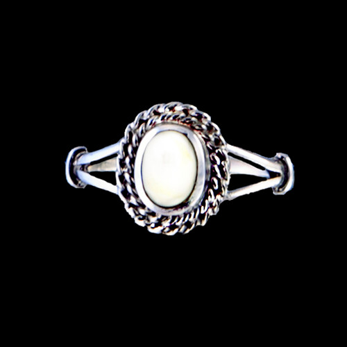 """This breathtaking oval shaped mammoth ivory design is inlayed into a elegant sterling silver ring with a rope border. The dimension of the stone on the ring is approximately .36"""" x .415""""."""