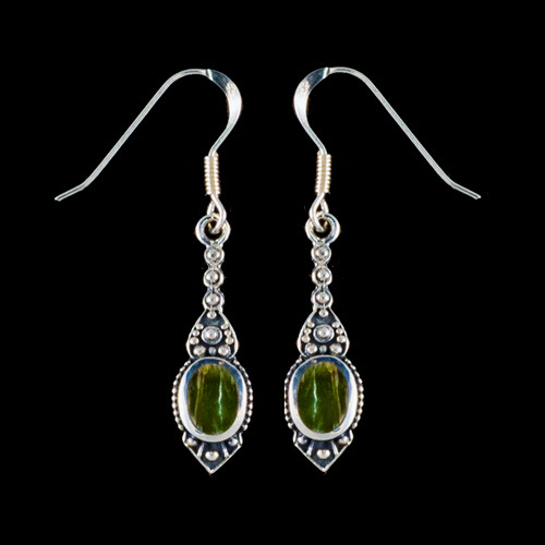 "This chic small oval Alaskan Jade is inlayed into a stylish dangle Sterling Silver earring with french wire.  The measurements of the earrings are approximately .96"" x .29""."