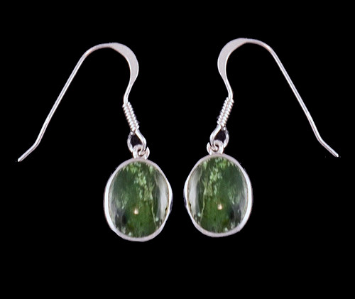 "This trendy Oval Shaped Alaskan Jade piece is inlayed into a Sterling Silver french wire earring.  The measurements of the earrings are approximately .375 x .380""."