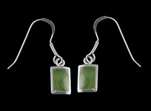 "This sharp small rectangle shaped Alaskan Jade piece is inlayed into a Sterling Silver french wire earring.  The measurements of the earrings are approximately .26 x .42""."