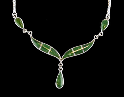 """This unique whale tail with Teardrop Alaskan Jade shaped whale tail is inlayed into a sterling silver pendant. This pendant comes with an 18"""" Sterling Silver chain. The dimensions of theAlaskan Jade pendant is approximately 2.25"""" x 1.7""""."""