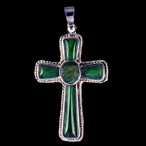 """This striking large cross shaped Alaskan Jade piece is inlayed into a sterling silver pendant. This pendant comes with an 18"""" Sterling Silver chain. The dimensions of theAlaskan Jade pendant is approximately 1.23"""" x .79""""."""