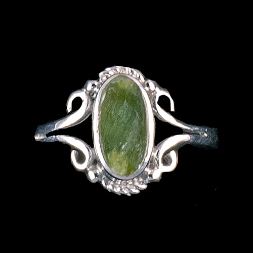 "Victorian Oval Shaped Alaskan Jade Sterling Silver Ring | F&F Inc.This charming victorian oval shaped Alaskan Jade design is inlayed into an elegant sterling silver ring.  The dimension of the stone on the ring is approximately .236"" x .394"".  The product id # is RJ-1024-S.         This ring comes in the following sizes for the sterling silver ring band.  Size 5, 6, 7, 8, 9 and 10"