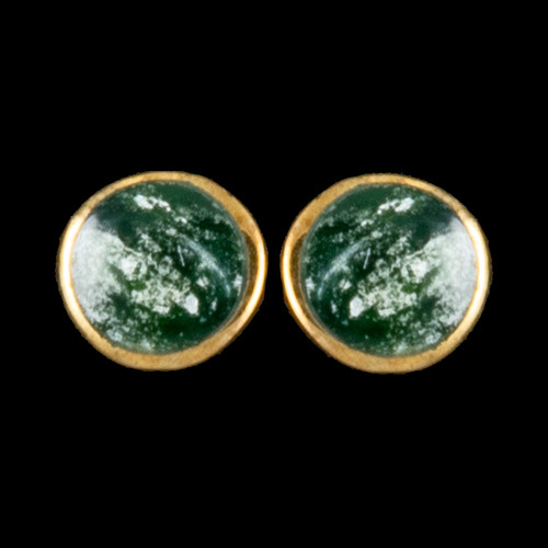 "This trendy round Alaskan Jade is inlaid into a beautiful 14K Gold earring.  These unique earrings have a post backing.  The diameter of the round mammoth tusk is approximately .29""."