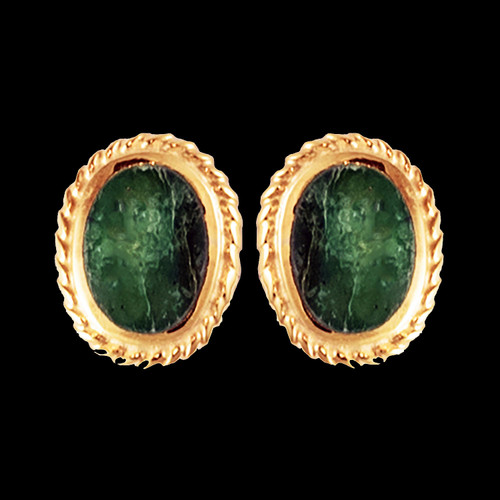 """These trendy oval shaped Alaskan Jade piece is inlaid into a stylish 14K Gold earring that is accentuated with rope 14K Gold border. These stylish earrings have a post backing. The measurements of the earrings are approximately .41"""" x .32""""."""