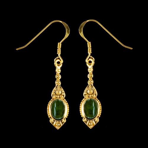 """This chic small oval Alaskan Jade is inlayed into a stylish dangle 14K Gold earring with french wire. The measurements of the earrings are approximately .96"""" x .29""""."""