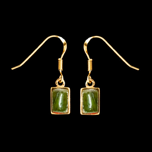 """This sharp small rectangle shaped Alaskan Jade piece is inlaid into a 14K Gold french wire earring. The measurements of the earrings are approximately .26 x .42""""."""