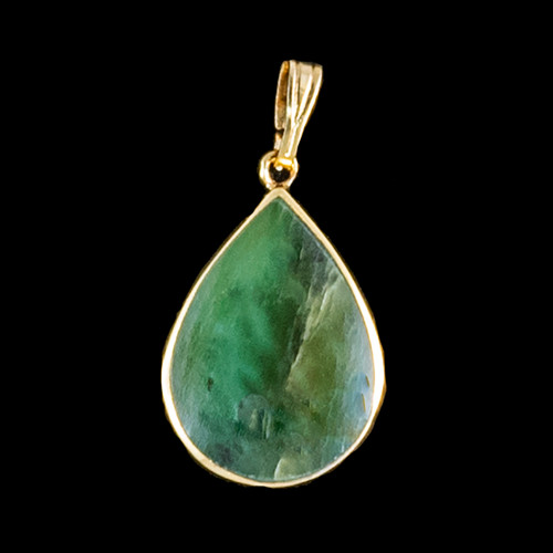 "Teardrop Alaskan Jade 14K Gold Pendant | F&F Inc.This charming teardrop oval shaped Alaskan Jade piece is inlayed into a 14K Gold pendant.  This pendant comes with an 18"" 14K Gold chain.  The dimensions of the Alaskan Jade pendant is approximately .82"" x .50"".  The product id # is PJ-1204-G.It is a 14K plate on sterling silver. The plating is with 30mils of 14k gold. Typically plating is done with 3mils of gold. We work with the extra gold plating to ensure your beautiful jewelry piece will have a strong gold color for years to come!!"
