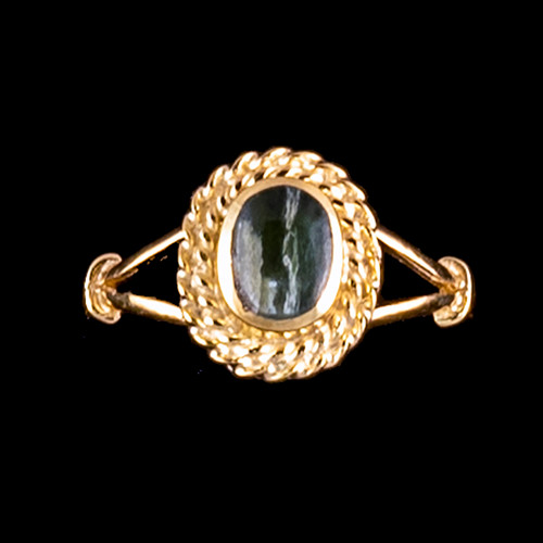 "Oval Shaped Alaskan Jade with Rope Border 14K Gold Ring | F&F Inc.This breathtaking oval shaped Alaskan Jade design is inlayed into a elegant 14K Gold ring with a rope border.  The dimension of the stone on the ring is approximately .36"" x .415"".  The product id # is RJ-1017-G          This ring comes in the following sizes for the 14K Gold ring band.  Size 5, 6, 7, 8, 9 and 10"