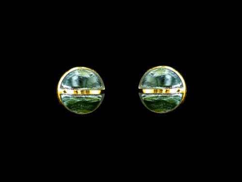 """This trendy round Alaskan Jade is inlaid into a beautiful 14k Gold earring. These unique earrings have a post backing. The diameter of the round mammoth tusk is approximately .29""""."""