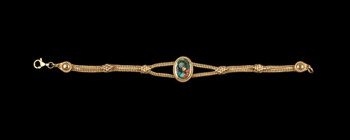 "This trendy round Northern Light is inlayed into a breathtaking single stone oval shaped shaped 14K Gold bracelet.    The dimension of the bracelet is approximately 7"" x .65""."
