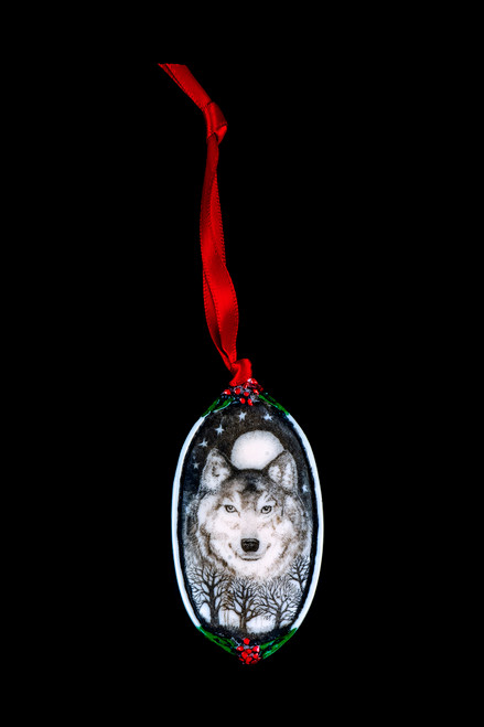 """Wolf Face This is a beautiful double sided ornament with a wolf theme. This is part of the incredible line of Mossup Valley Designs that we carry, with the wonderful artist Rachel Badeau. The dimensions of the ornament are  3.28"""" x 1.61"""". The SKU is MVD ORN 11."""