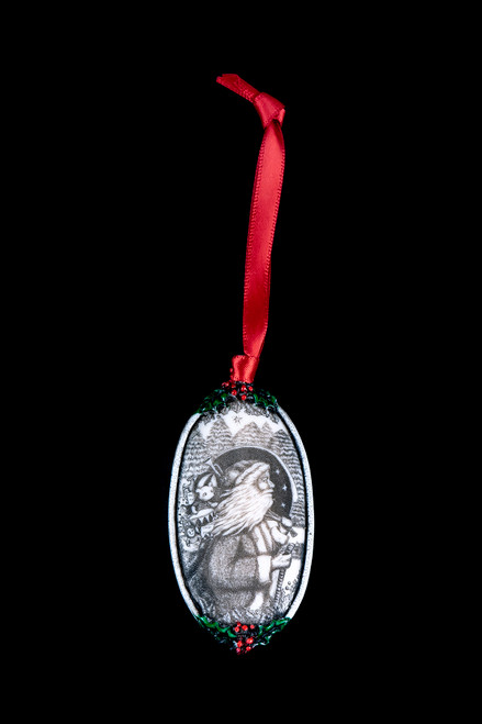 """Santa This is a beautiful double sided ornament with a Christmas theme. This is part of the incredible line of Mossup Valley Designs that we carry, with the wonderful artist Rachel Badeau. The dimensions of the ornament are 3.28"""" x 1.61"""". The SKU is MVD ORN 11."""