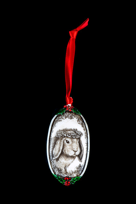 "Bunny Ears Down This is a beautiful double sided ornament with a Bunny theme.  This is part of the incredible line of Mossup Valley Designs that we carry, with the wonderful artist Rachel Badeau.  The dimensions of the ornament are 3.28"" x 1.61"".  The SKU is MVD ORN 2."