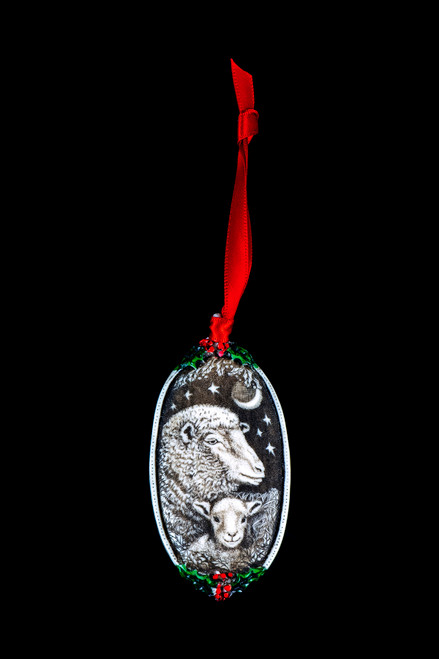 "Sheep Face This is a beautiful double sided ornament with a Sheep theme.  This is part of the incredible line of Mossup Valley Designs that we carry, with the wonderful artist Rachel Badeau.  The dimensions of the ornament are 3.28"" x 1.61"".  The SKU is MVD ORN 11."