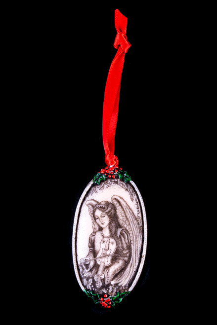 """This is a beautiful double sided ornament with a Angel theme. This is part of the incredible line of Mossup Valley Designs that we carry, with the wonderful artist Rachel Badeau. The dimensions of the ornament are 3.28"""" x 1.61"""". The SKU is MVD ORN 5.  On this double sided ornament, an Angel if prominently featured on both sides. On one side there is Angel holding a Rabbit. On the other side of the ornament, an Angel is playing a violin.  Rachel Badeau has been etching and engraving in a variety of media for over thirty years. Her work, characterized by fine line and intricate detail, attempts to touch the hearts and emotions of others. All while reflecting her love of animals, nature and the human spirit."""