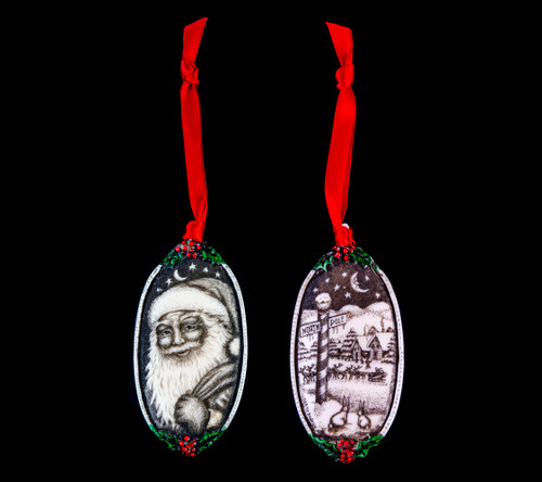 """This is a beautiful double sided ornament with a Santa theme. This is part of the incredible line of Mossup Valley Designs that we carry, with the wonderful artist Rachel Badeau. The dimensions of the ornament are 3.28"""" x 1.61"""". The SKU is MVD ORN 9.  On this double sided ornament, Christmas designs are prominently featured on both sides. On one side there is closeup of Santa's face while holding a bag of toys design. On the other side of the ornament, a North Pole Design.  Rachel Badeau has been etching and engraving in a variety of media for over thirty years. Her work, characterized by fine line and intricate detail, attempts to touch the hearts and emotions of others. All while reflecting her love of animals, nature and the human spirit."""