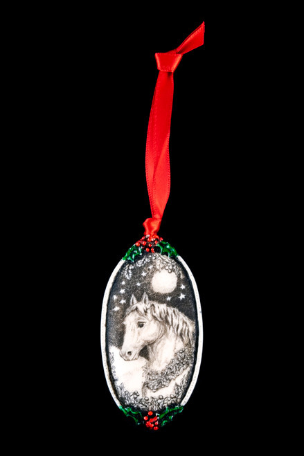 "This is a beautiful double sided ornament with a Horse theme.  This is part of the incredible line of Mossup Valley Designs that we carry, with the wonderful artist Rachel Badeau.  The dimensions of the ornament are 3.28"" x 1.61"".  The SKU is MVD ORN 4.  On this double sided ornament, Horse Themed designs are prominently featured on both sides.  On one side there is closeup of a Horse face.  On the other side of the ornament, a Horse drawn Sleigh.  Rachel Badeau has been etching and engraving in a variety of media for over thirty years.  Her work, characterized by fine line and intricate detail, attempts to touch the hearts and emotions of others.  All while reflecting her love of animals, nature and the human spirit."