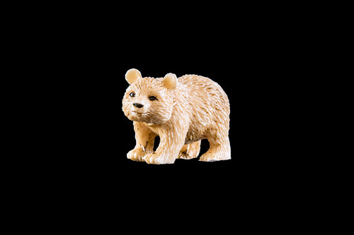 """This is a beautiful hand carved eco-ivory Walking Bear Statue. The dimensions of the Walking Bear Statue are .77"""" x 1.10"""" x 2.04"""". The SKU is C-16.  This unique Bear Sitting statue will make a great addition to any room in the house. You can place it on any flat surface to diplay, or a great gift for children to have.  All statues are hand carved in clay. We then make a mold of the original piece before producing them into the final acrylic resin product."""