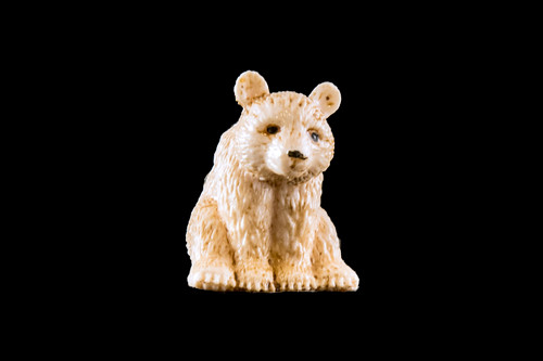 "This is a beautiful hand carved eco-ivory Sitting Bear Statue.  The dimensions of the Sitting Bear  are .86"" x 1.35"" x 1.52"".  The SKU is C-14.  This unique Sitting Bear statue will make a great addition to any room in the house.  You can place it on any flat surface to diplay, or a great gift for children to have.  All statues are hand carved in clay.  We then make a mold of the original piece before producing them into the final acrylic resin product with an antique finish."