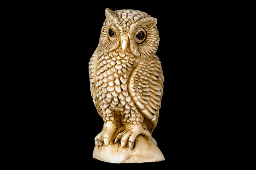 "This is a beautiful hand carved eco-ivory Owl Statue.  The dimensions of the Owl are .90"" x 1.82"" x .79"".  The SKU is C-17.  This unique Sitting Bear statue will make a great addition to any room in the house.  You can place it on any flat surface to diplay, or a great gift for children to have.  All statues are hand carved in clay.  We then make a mold of the original piece before producing them into the final acrylic resin product with an antique finish."