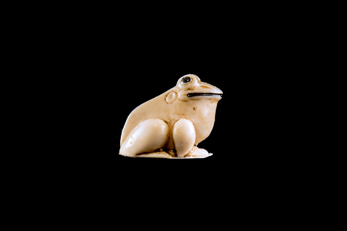"""This is a beautiful hand carved eco-ivory Bullfrog Statue. The dimensions of the Bullfrog Statue are 0.77"""" x .67"""" x .82"""". The SKU is C-20.  This unique Bullfrog Statue statue will make a great addition to any room in the house. You can place it on any flat surface to diplay, or a great gift for children to have.  All statues are hand carved in clay. We then make a mold of the original piece before producing them into the final acrylic resin product with an antique finish."""