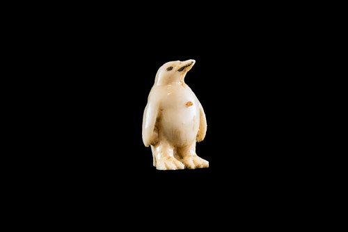"""This is a beautiful hand carved eco-ivory Baby Penguin Statue. The dimensions of the Baby Penguin Statue are 0.64"""" x 1.0"""" x .55"""". The SKU is C-22.  This unique Baby Penguin Statue statue will make a great addition to any room in the house. You can place it on any flat surface to diplay, or a great gift for children to have.  All statues are hand carved in clay. We then make a mold of the original piece before producing them into the final acrylic resin product with an antique finish."""