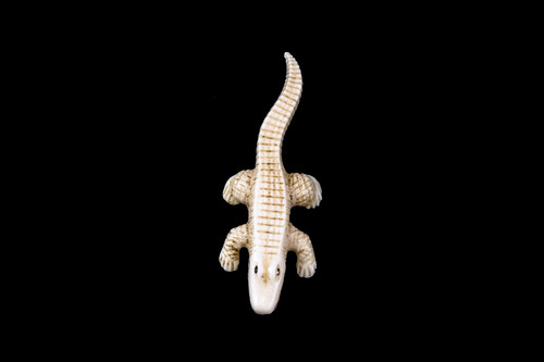 "This is a beautiful hand carved eco-ivory Alligator Statue.  The dimensions of the Alligator Statue are 1.09"" x .43"" x 3.11"".  The SKU is C-38.  This unique Alligator Statue statue will make a great addition to any room in the house.  You can place it on any flat surface to diplay, or a great gift for children to have.  All statues are hand carved in clay.  We then make a mold of the original piece before producing them into the final acrylic resin product with an antique finish."
