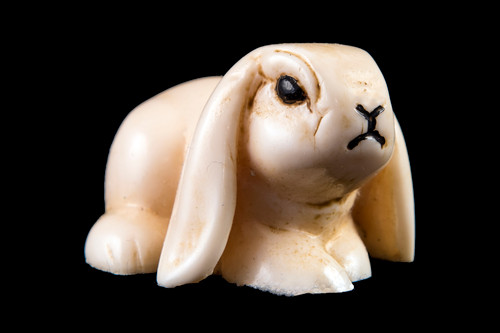 "This is a beautiful hand carved eco-ivory Bunny Statue.  The dimensions of the Bunny Statue are 1.36"" x 1.22"" x 2.13"".  The SKU is C-30.  This unique Rabbit Statue statue will make a great addition to any room in the house.  You can place it on any flat surface to diplay, or a great gift for children to have.  All statues are hand carved in clay.  We then make a mold of the original piece before producing them into the final acrylic resin product with an antique finish."