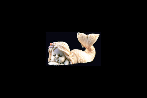 "This is a charming hand carved eco-ivory Sleeping Mermaid Statue.  The dimensions of the Sleeping Mermaid Statue are 1.94"" x 1.10"" x .79.  The SKU is C-55.  This unique Sleeping Mermaid Statue statue will make a great addition to any room in the house.  You can place it on any flat surface to diplay, or a great gift for children to have.  All statues are hand carved in clay.  We then make a mold of the original piece before producing them into the final acrylic resin product with an antique finish."