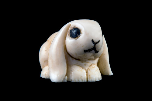 "This is a detailed hand carved eco-ivory Small Bunny Statue  The dimensions of the Small Bunny Statue are 1.04"" x 0.87"" x 1.29"".  The SKU is C-31.    This stunning Small Bunny Statue will make a great addition to any room in the house.  You can place it on any flat surface to display, or a great gift for children to have.  All statues are hand carved in clay.  We then make a mold of the original piece before producing them into the final acrylic resin product with an antique finish."