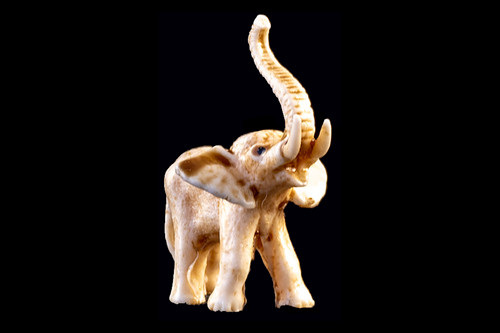 """This is a detailed hand carved eco-ivory Elephant Ears Up Statue. The dimensions of the Elephant Ears Up Statue are 0.86"""" x 1.47"""" x 1.45"""". The SKU is C-4.  This beautiful Elephant Ears Up Statue statue will make a great addition to any room in the house. You can place it on any flat surface to display, or a great gift for children to have.  All statues are hand carved in clay. We then make a mold of the original piece before producing them into the final acrylic resin product with an antique finish."""