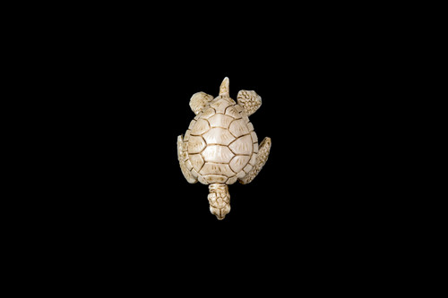"""This is a beautiful hand carved eco-ivory Turtle Flippers In Statue. The dimensions of the Turtle Flippers In Statue are 1.41"""" x 0.67"""" x 2.11"""". The SKU is C-26.  This unique Turtle Flippers In Statue will make a great addition to any room in the house. You can place it on any flat surface to display, or a great gift for children to have."""
