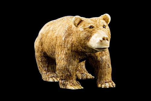 """This is a beautiful hand carved eco-ivory Large Bear Statue. The dimensions of the Large Bear Statue are 2.04"""" x 2.74"""" x 5.34"""". The SKU is C-47.  This uniqueLarge Bear Statue will make a great addition to any room in the house. You can place it on any flat surface to display, or a great gift for children to have.  This piece was originally hand carved by Sheryl Tray, an artist located in Hawaii. The artwork you see here is a memory, captured in clay by Sheryl in her many travels. The clay original, sculpted in her small studio in Honolulu, is sent to a sent to us to be cast in either metal or resin and presented here for you to enjoy. Please take a piece home for yourself, or as a present for a special friend who loves and values the great outdoors as much as Sheryl."""