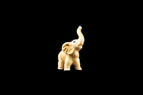 "This is a exquisite hand carved eco-ivory Mini Elephant Statue.  The dimensions of the Mini Elephant Statue are 0.52"" x 1.22"" x 0.93"".  The SKU is C-60.  This unique Mini Elephant Statue will make a great addition to any room in the house.  You can place it on any flat surface to display, or a great gift for children to have."