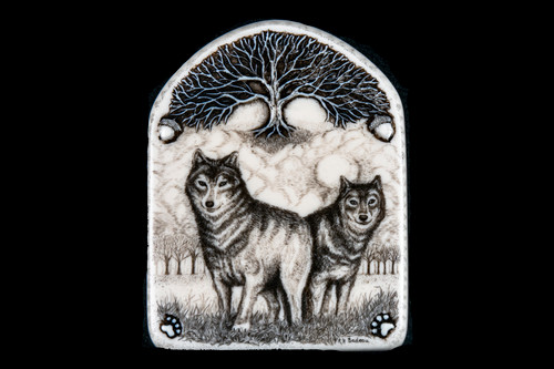 "This is a gorgeous wall plaque was originally hand etched Small Wolves Wall Plaque design.  This is part of the incredible line of Mossup Valley Designs that we carry, with the wonderful artist Rachel Badeau.  The dimensions of the plaque are 3.31"" x 4.32"" x 0.32"".  The SKU is MVD WP 9.  Rachel Badeau has been etching and engraving in a variety of media for over thirty years.  Her work, characterized by fine line and intricate detail, attempts to touch the hearts and emotions of others.  All while reflecting her love of animals, nature and the human spirit.    The resin scrimshaw piece is originally hand etched by Rachel Badeau.  We make a mold of the original piece and do an open cast pour of our resin mixture.  The pieces are removed from the mold and sanded and inked."