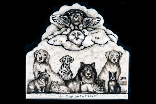 """This is a gorgeous wall plaque was originally hand etched Small All Dogs go to Heaven Wall Plaque design. This is part of the incredible line of Mossup Valley Designs that we carry, with the wonderful artist Rachel Badeau. The dimensions of the plaque are 4.26"""" x 4.10"""" x 0.61"""". The SKU is MVD WP 6.  Rachel Badeau has been etching and engraving in a variety of media for over thirty years. Her work, characterized by fine line and intricate detail, attempts to touch the hearts and emotions of others. All while reflecting her love of animals, nature and the human spirit.  The resin scrimshaw piece is originally hand etched by Rachel Badeau. We make a mold of the original piece and do an open cast pour of our resin mixture. The pieces are removed from the mold and sanded and inked."""