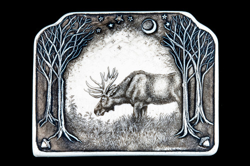 """This is a beautiful wall plaque was originally hand etched Grazing Moose Wall Plaque design. This is part of the incredible line of Mossup Valley Designs that we carry, with the wonderful artist Rachel Badeau. The dimensions of the plaque are 5.34 x 4.22"""" x 0.30"""". The SKU is MVD WP 15.  This stunning piece has a unique 3D design carved into the design of the piece. Both the moon in the center as well as the tree's on the sides of the pieces are carved in to give it the 3D design!  Rachel Badeau has been etching and engraving in a variety of media for over thirty years. Her work, characterized by fine line and intricate detail, attempts to touch the hearts and emotions of others. All while reflecting her love of animals, nature and the human spirit."""