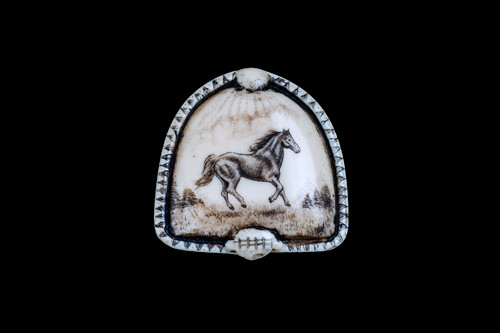 """This distinct originally hand etched Horse designed pin/pendant. The backing of this piece has the findings to be a pin, as well as a pendant. They come with an 18"""" Silver Plated Chain. This is part of the incredible line of Mossup Valley Designs that we carry, with the wonderful artist Rachel Badeau. The dimensions of the necklace are 1.36"""" x 1.35"""" x 0.36"""". The SKU is MVD PN 43.  Rachel Badeau has been etching and engraving in a variety of media for over thirty years. Her work, characterized by fine line and intricate detail, attempts to touch the hearts and emotions of others. All while reflecting her love of animals, nature and the human spirit.  The resin scrimshaw piece is originally hand etched by Rachel Badeau. We make a mold of the original piece and do an open cast pour of our resin mixture. The pieces are removed from the mold and sanded and inked."""