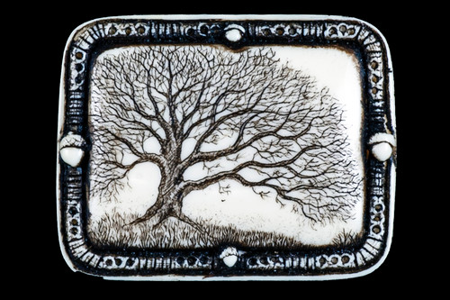 "This distinct originally hand etched Woodland designed pin/pendant.  The Woodland design features an Oak Tree.  The backing of this piece has the findings to be a pin, as well as a pendant.  They come with an 18"" Silver Plated Chain.  This is part of the incredible line of Mossup Valley Designs that we carry, with the wonderful artist Rachel Badeau.  The dimensions of the necklace are 1.82"" x 1.41"" x 0.43"".  The SKU is MVD PN 11.  Rachel Badeau has been etching and engraving in a variety of media for over thirty years.  Her work, characterized by fine line and intricate detail, attempts to touch the hearts and emotions of others.  All while reflecting her love of animals, nature and the human spirit.    The resin scrimshaw piece is originally hand etched by Rachel Badeau.  We make a mold of the original piece and do an open cast pour of our resin mixture.  The pieces are removed from the mold and sanded and inked."