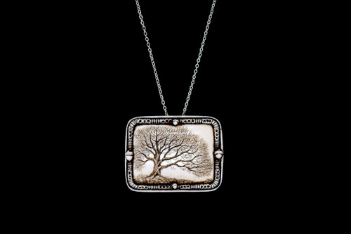 """MVD PN 11 Woodland Chain.  With our unique backing, you can wear this stunning piece either as a pin or pendant with the included 18"""" Silver Plated Chain. This distinct originally hand etched Woodland designed pin/pendant. The Woodland design features an Oak Tree. The backing of this piece has the findings to be a pin, as well as a pendant. They come with an 18"""" Silver Plated Chain. This is part of the incredible line of Mossup Valley Designs that we carry, with the wonderful artist Rachel Badeau. The dimensions of the necklace are 1.82"""" x 1.41"""" x 0.43"""". The SKU is MVD PN 11.  Rachel Badeau has been etching and engraving in a variety of media for over thirty years. Her work, characterized by fine line and intricate detail, attempts to touch the hearts and emotions of others. All while reflecting her love of animals, nature and the human spirit."""