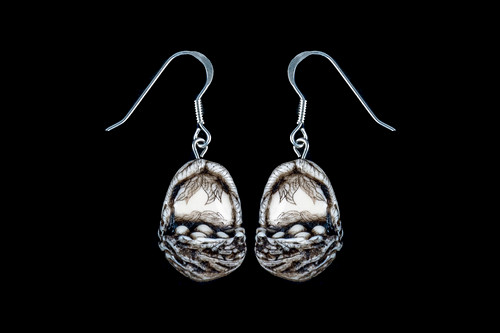 "This is a unique originally hand etched Robins Nest French Wire Earring set. This is part of the incredible line of Mossup Valley Designs that we carry, with the wonderful artist Rachel Badeau.  All the earrings come carded.  The dimensions of the earrings are 0.58"" x 0.83"" x 0.41"".  The SKU is MVD ER 05.  Rachel Badeau has been etching and engraving in a variety of media for over thirty years.  Her work, characterized by fine line and intricate detail, attempts to touch the hearts and emotions of others.  All while reflecting her love of animals, nature and the human spirit.    The resin scrimshaw piece is originally hand etched by Rachel Badeau.  We make a mold of the original piece and do an open cast pour of our resin mixture.  The pieces are removed from the mold and sanded and inked."