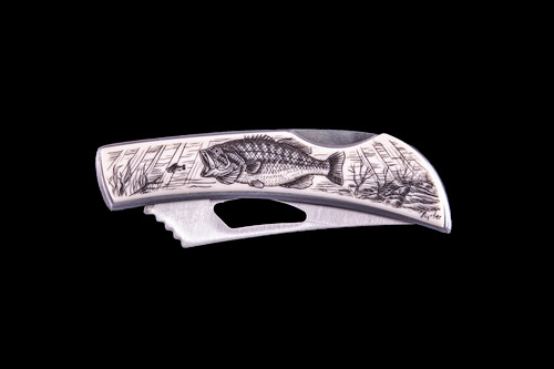"""This beautiful originally hand etched Bass design on a Stainless Steel Silver Hawk Knife. The back of the knife has a belt clip and all the knifes come with the pictured sheath. It is a lock blade knife. The artwork was originally hand etched by Linda Layden. The dimensions of the Silver Hawk knife with the blade closed are 3.00"""" x 0.96"""" x 0.55"""". The blade itself is approximately 2.35"""" making the width of the knife with an open blade 5.35"""". The SKU is NC 14 - 101.  Linda Layden has been making beautiful works of art in the scrimshaw field for over 40 years. Originally a hobby that became a full time job. Her work can be found in gift shops, galleries and museums across the world."""