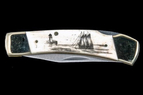 "This distinct hand etched Classic Black inked Scrimshaw Ship and Lighthouse design on a 440 Stainless Steel Blade LB 5 Knife.  This beautiful knife is part of the Scrimshaw Collection, with those words laser engraved into the blade.  The LB 5 knifes come with the pictured leather sheath and each scale is made with Bovine Bone.  The LB 5 Knife has bolsters and shackle that are nickel silver with brass pins and liner.  It is a lock blade knife and a very useful pocket knife. The dimensions of the LB 5 Pocket Knife with the blade closed are 3.71"" x 0.90"" x 0.39"".  The blade itself is approximately 2.80"" making the width of the knife with an open blade 6.51"".  The SKU is LB-5 401.  The scrimshaw is inked with black india ink and sealed with renaissance wax, which is used by museums for antique restoration.  It also helps bring out the beauty of the artwork as well as in the cow bone. The knife is water resistant, but not waterproof."