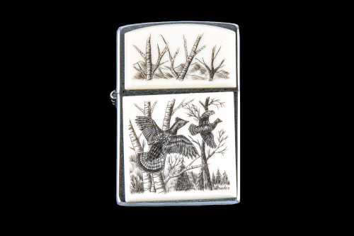 """This is a beautifully originally hand etched Eco-Ivory Ruffed Grouse designed Zippo Lighter! The top of the flip lighter has a a Birch Tree's design. The Zippo is a Brushed Chrome finish. Each lighter has a bottom stamp signifying the year it was made, is refillable. All windproof lighters are American made in Bradford, PA factory and come packaged in a gift box. This is part of the Save the Elephant Collection and was originally hand etched by Linda Layden. The SKU is NC 54 - 120  The Zippo Lighter is 2.24"""" x 1.51"""" x 0.59"""". It weighs 2.04 oz."""
