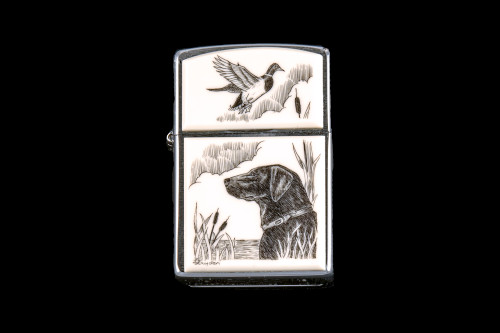 "This is a unique originally hand etched Eco-Ivory Black Lab designed Zippo Lighter! The top of the flip lighter has a a Duck flying away.   The Zippo is a Brushed Chrome finish. Each lighter has a bottom stamp signifying the year it was made, is refillable. All windproof lighters are American made in Bradford, PA factory and come packaged in a gift box.  This is part of the Save the Elephant Collection and was originally hand etched by Linda Layden. The SKU is NC 54 - 142  The Zippo Lighter is 2.24"" x 1.51"" x 0.59"".  It weighs 2.04 oz."