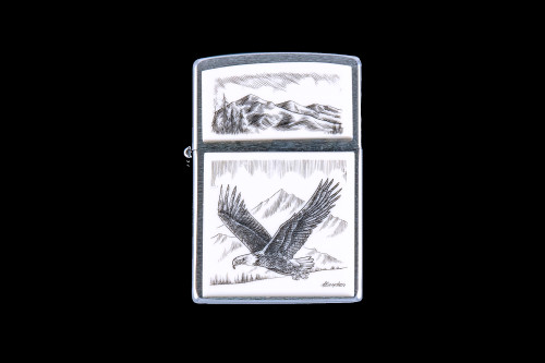 "This is a beautiful originally hand etched Eco-Ivory Scrimshaw Flying Eagle designed Zippo Lighter! The top of the flip lighter has a a Mountain Skyline Top piece.  The Zippo is a Brushed Chrome finish. Each lighter has a bottom stamp signifying the year it was made, is refillable. All windproof lighters are American made in Bradford, PA factory and come packaged in a gift box.  This is part of the Save the Elephant Collection and was originally hand etched by Linda Layden. The SKU is NC 54 - 162A.  The Zippo Lighter is 2.24"" x 1.51"" x 0.59"".  It weighs 2.04 oz."